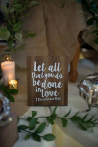 Let al that you do be done in love Bible verse wedding sign at a reception