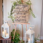 "Wood crates and white lanterns with a pallet wood Bible verse ""I have found the One whom my soul loves"" wedding decor"