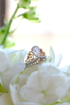 Disney engagement ring on white flowers