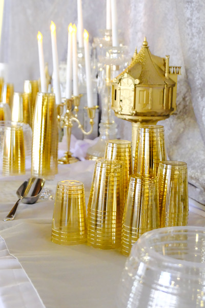gold and silver Disney castles wedding drink table